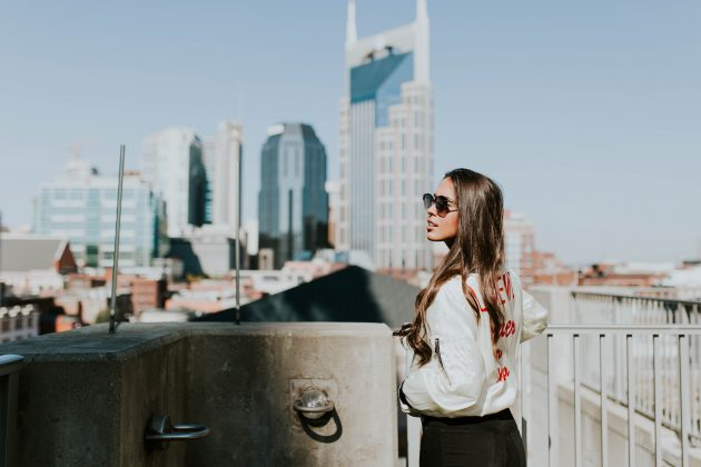 Model with sunglasses on walking outside