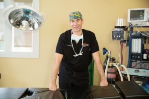 Dr. Robert Shenker smiling in operating scrubs