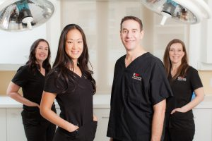 Four members of the Cosmetic Surgery clinical surgical staff staring at camera