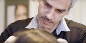 Majid Memand injecting on patient