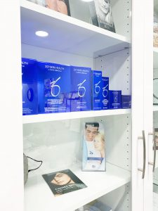 Skincare products on white shelves