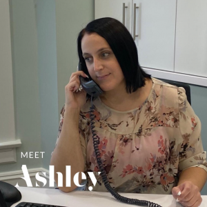 Ashley answers a phone in the clinic.